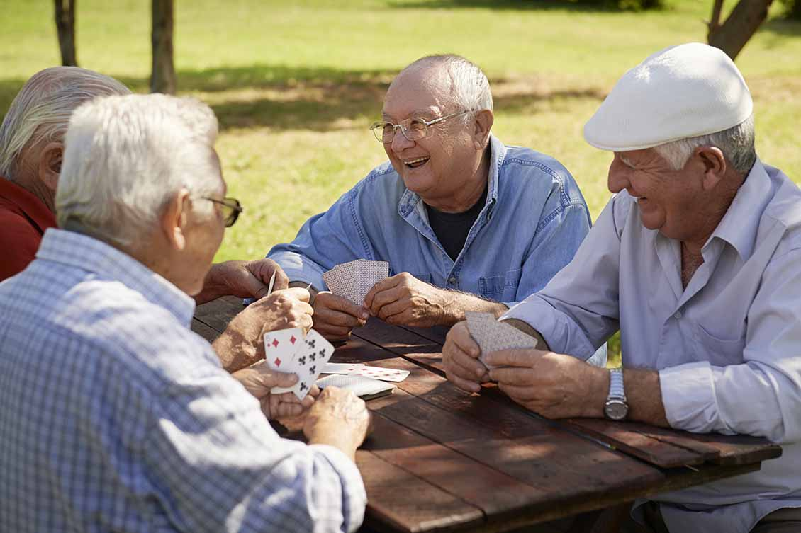 Seniors Playing Cards in the Park